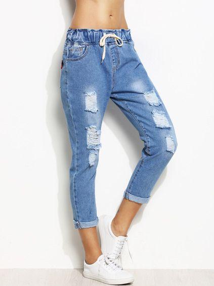 рваные женские джинсы с отворотами